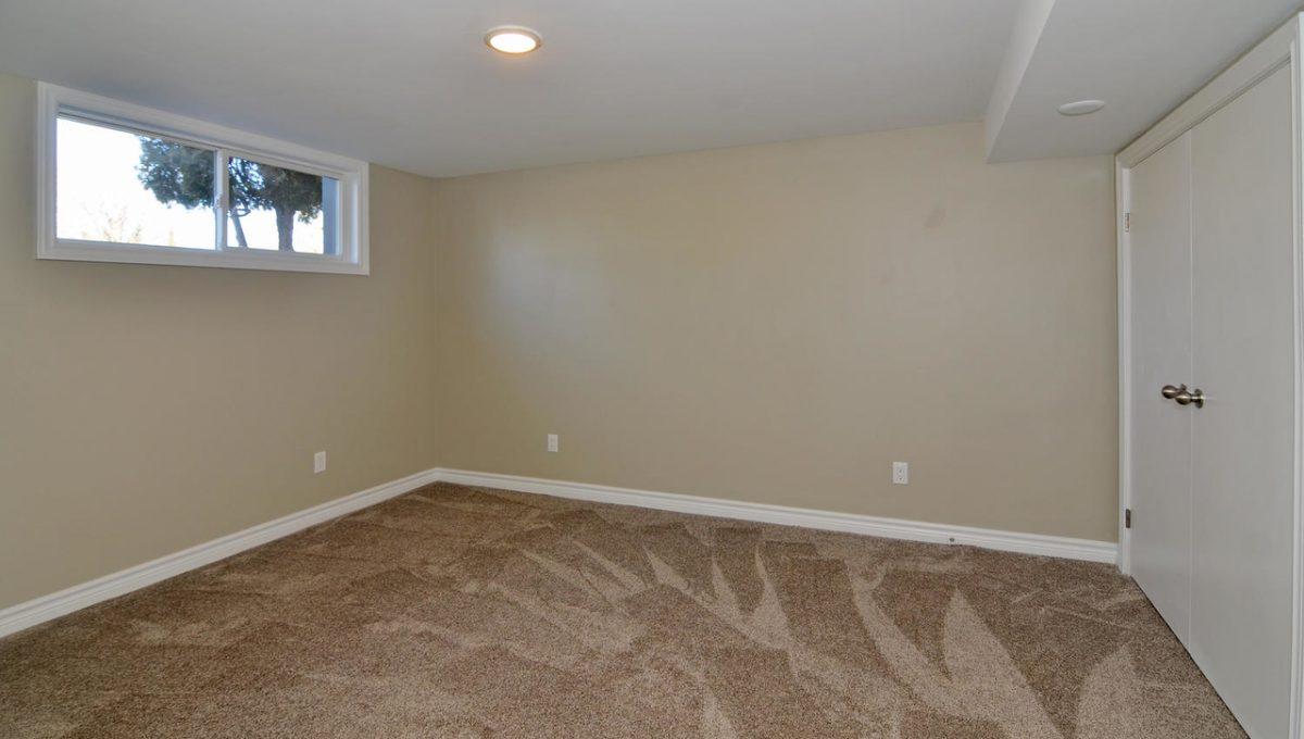 Model HomeDuplex-large-019-17-Lower Level Bedroom-1500x994-72dpi-X2